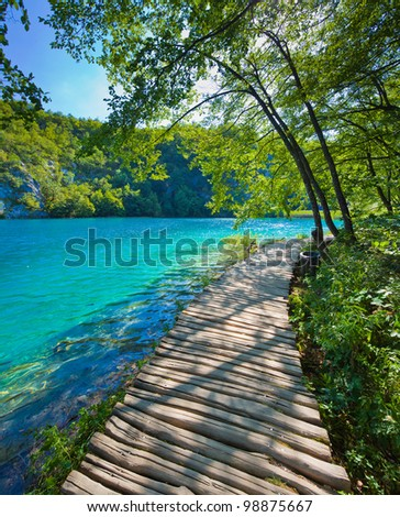 Blue lake and path - stock photo