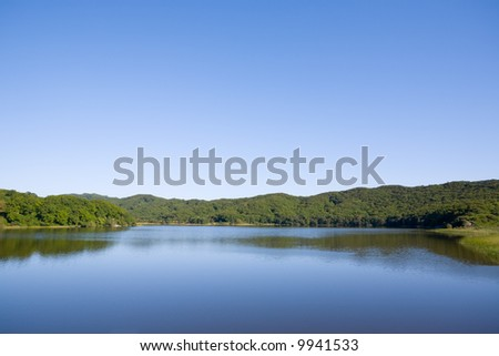 Blue lake in the evening - stock photo