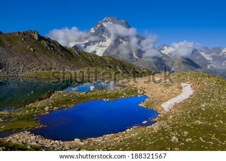 blue lake near psish mount - stock photo