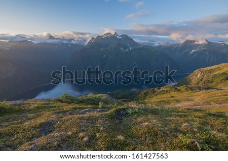 Blue Lake on Baranof Island in Alaska seen from high up on the slope of Bear Mountain  - stock photo