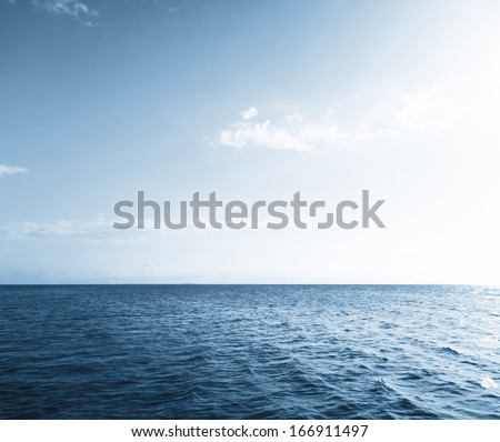 Blue lake water and sky - stock photo