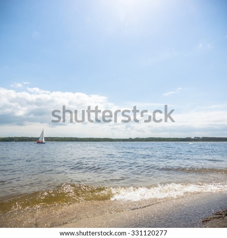 blue lake with cloudy sky, nature series - stock photo