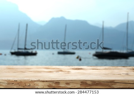 blue landscape of sea and boats and desk space of free  - stock photo