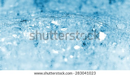 Blue lather closeup background - stock photo