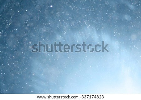 blue light background abstract bokeh light snow - stock photo