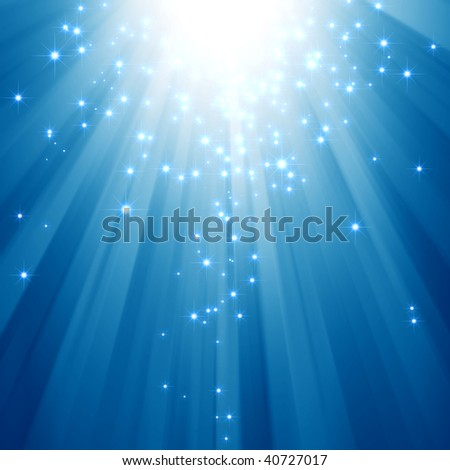 Blue light beams with glitter stars - stock photo