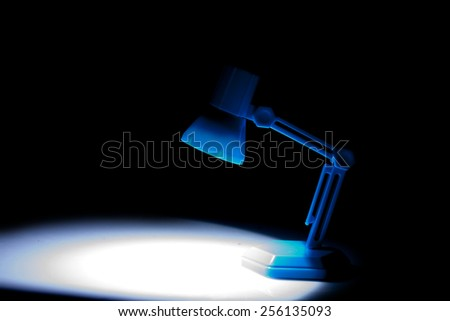 Blue light isolated on a black background - stock photo