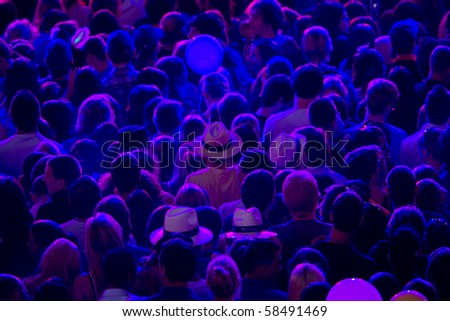 blue lighted crowd waiting for the start of the concert - stock photo