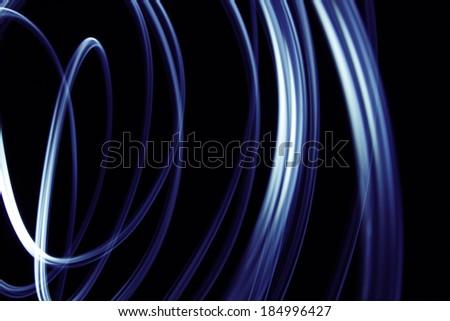 Blue lines on black background  - stock photo