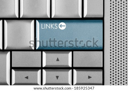 Blue LINKS key on a computer keyboard with clipping path around the LINKS key - stock photo