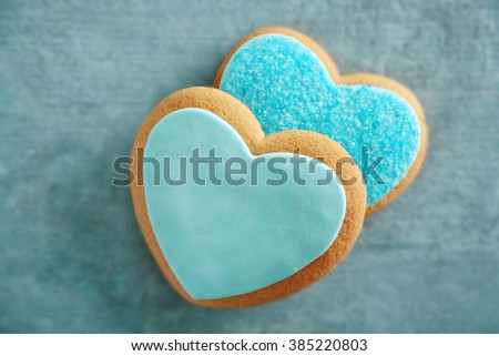 Blue love cookies on blue background, closeup - stock photo