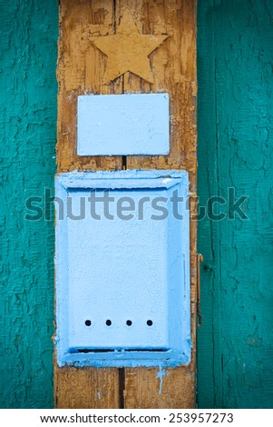 blue mailbox at the gate, close up - stock photo