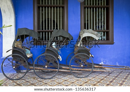 Blue Mansion in Georgetown, Malaysia. Photo of three Tuk-Tuk's. - stock photo