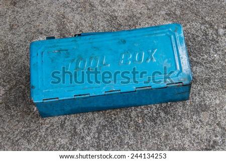 Blue Metal Tool Box on concrete floor - stock photo