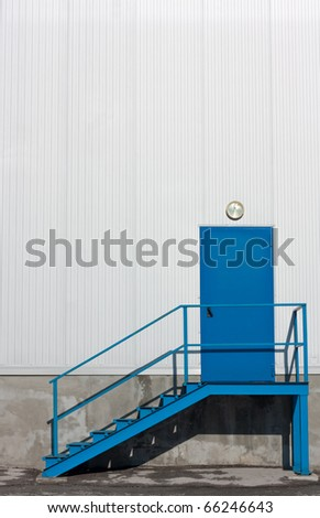 Blue,metal warehouse entry door with stairs - stock photo