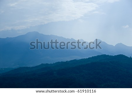 Blue morning mist in the Dolimites mountains, south Tirol Italy. - stock photo