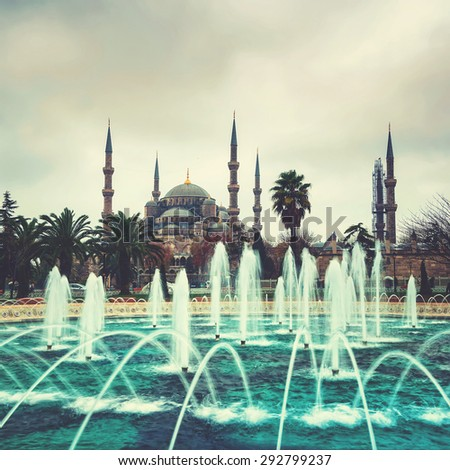 Blue Mosque in Istanbul, Turkey in cloudy rainy weather in winter. Fountain at the foreground - stock photo