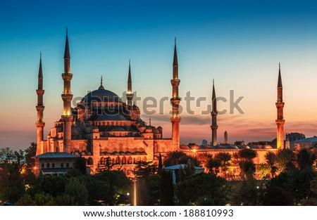Blue Mosque in Istanbul, with lantern light on blue sky background at sunset - stock photo