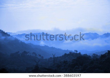 Blue mountains with foggy, blue background - stock photo
