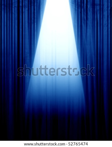 blue movie or theater curtain with a spotlight - stock photo