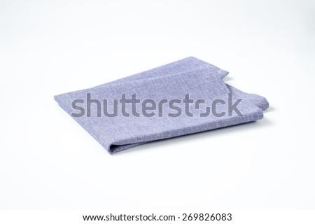 blue napkin on white background - stock photo