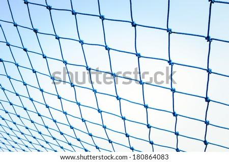 Blue net soccer goal.  - stock photo