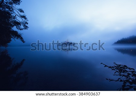 Blue night at the famous island with old church in the city of Bled, Slovenia, Europe - stock photo