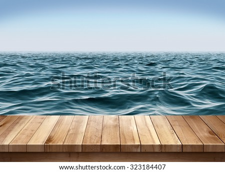Blue ocean and clear sky with wooden platform - stock photo