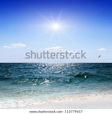 blue ocean on a summer day - stock photo