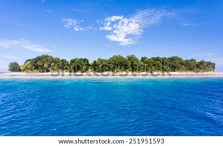 Blue ocean water and Idyllic tropical island of Sipadan in Sabah, Malaysia. - stock photo