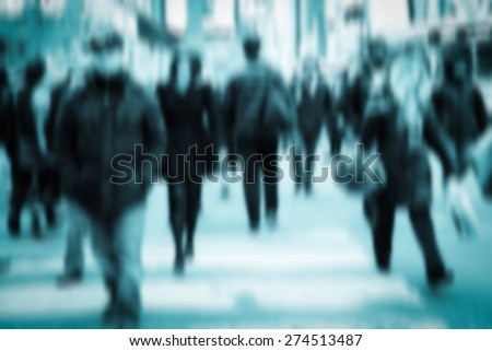 Blue of pedestrians on crowded city street. Toned image - stock photo