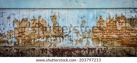 Blue old cracked wall of the abandoned ruins - stock photo