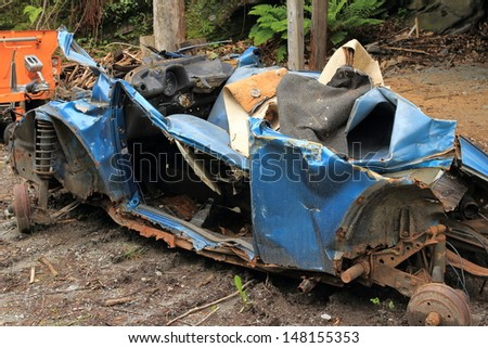 Blue old damaged rusty car wreck - stock photo