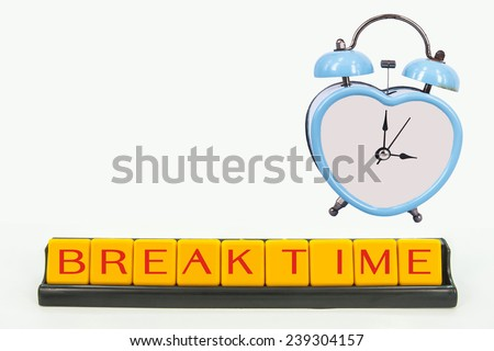 blue old retro clock on white background ,abstract background to break time. - stock photo