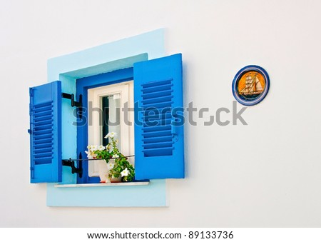 Blue old window in a house of Skiathos island Greece - stock photo