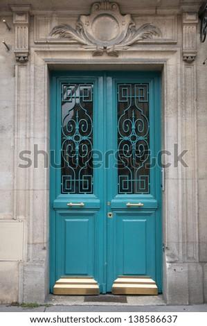 Blue old wooden door in Paris, France - stock photo