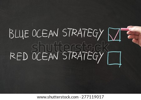 Blue or red ocean strategy words written on the blackboard using chalk - stock photo