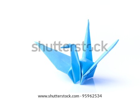 Blue origami bird isolated on white background - stock photo