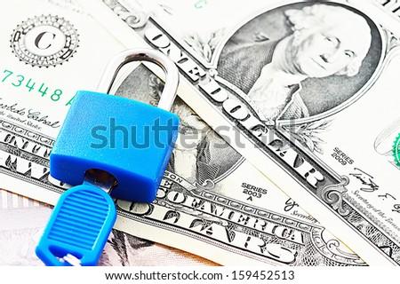 Blue padlock isolated on dollar background  - stock photo