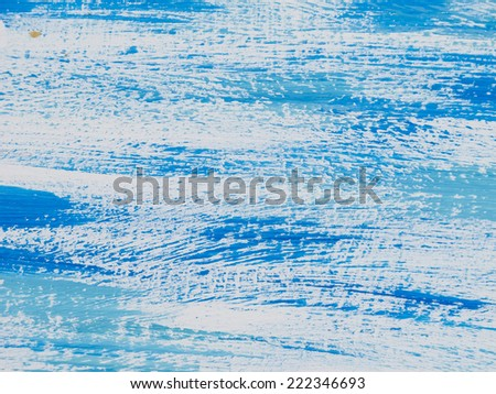 Blue painted abstract, with white streaks, reminiscent of seas or skies. - stock photo