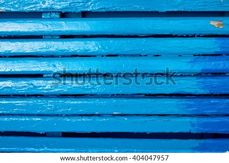 Blue painted panels on a bench, as a background image - stock photo