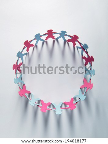 Blue paper men and red women united in circle - stock photo
