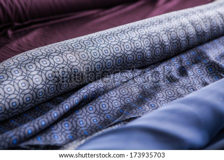blue Patterned fabric in rolls  - stock photo
