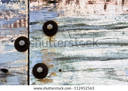 Blue Peeling Paint Background With Rusty Bolts Horizontal - stock photo