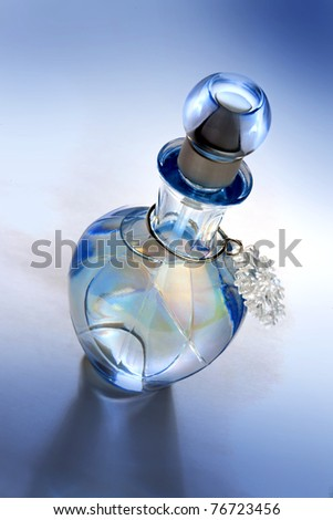 Blue perfume bottle - stock photo