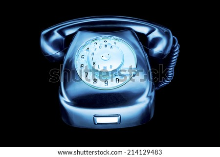 blue phone on black background - stock photo