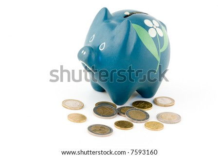 blue piggy bank with coins on white background - stock photo