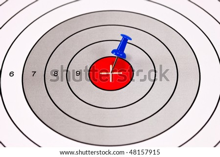 Blue Pin in a Red Centered Target With Crosshair - stock photo