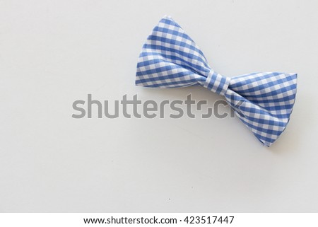 Blue plaid bow tie isolated on white background - stock photo