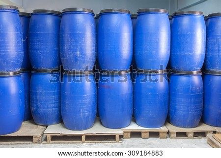Blue Plastic barrels contain chemical inside stack on palette - stock photo